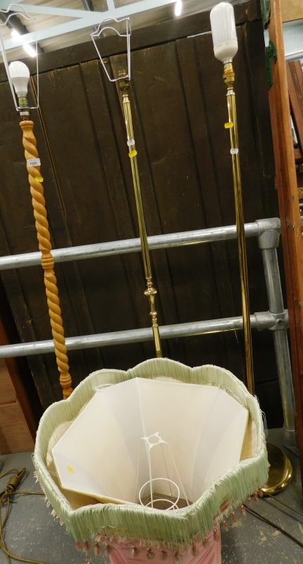 Three standard lamps, to include two brass examples, etc. (a quantity)