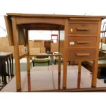 A mid 20thC oak office desk, the top with a foldover flap and three side drawers.
