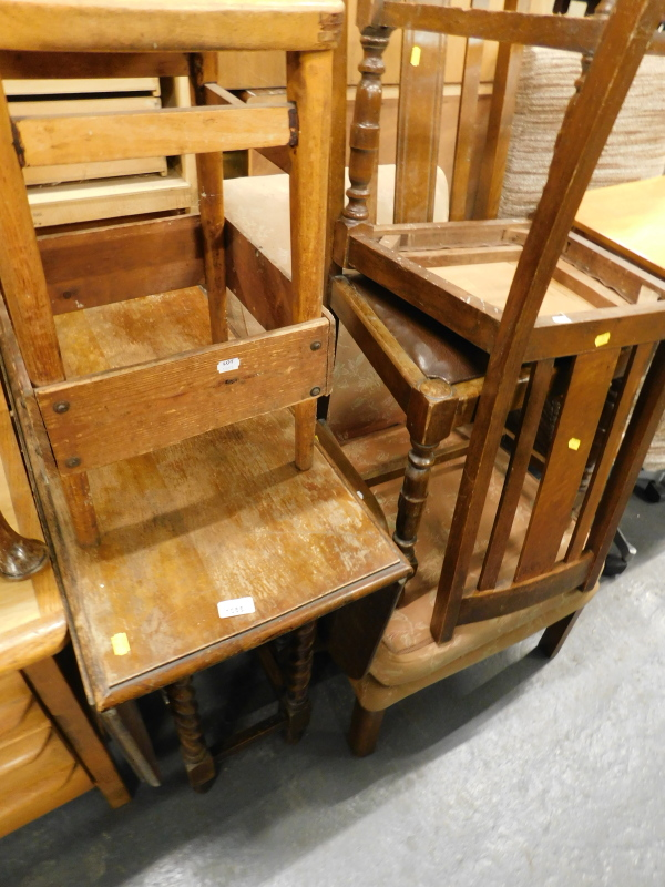 A collection of furniture, to include an oak drop leaf table on barley twist legs, an oak framed