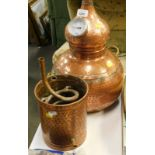 A hammered copper wine or spirit distiller.