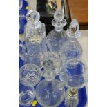 A quantity of cut glass decanters, jug, rose bowl, sugar sifter, avocado dishes, etc., (1 tray and