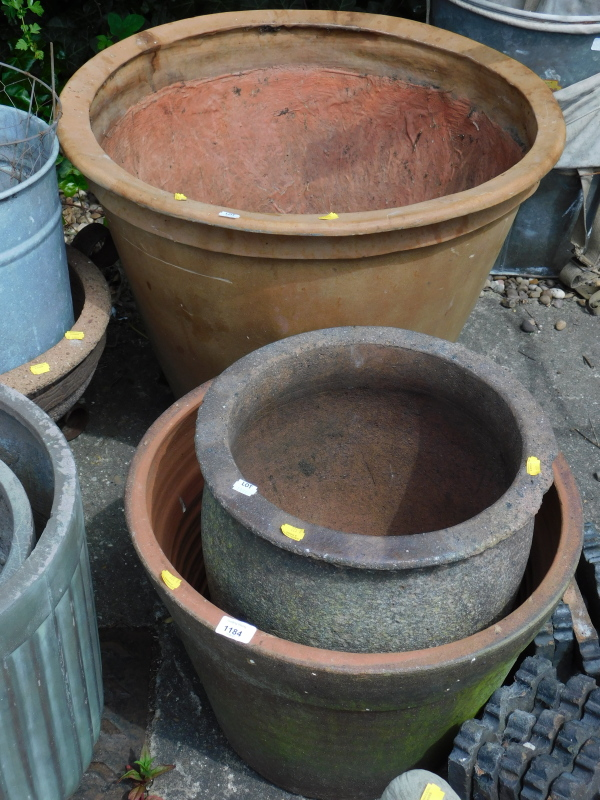 A large plastic plant pot, and two others.