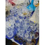 A quantity of glassware, to include a cranberry glass jug, various drinking glasses, vases, jelly