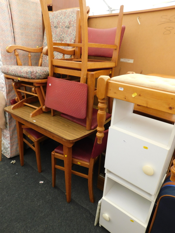 A collection of furniture, to include an extending kitchen table, various chairs, a rocking chair,