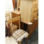 A collection of furniture, to include chest of drawers, two chairs with drop in seats, three