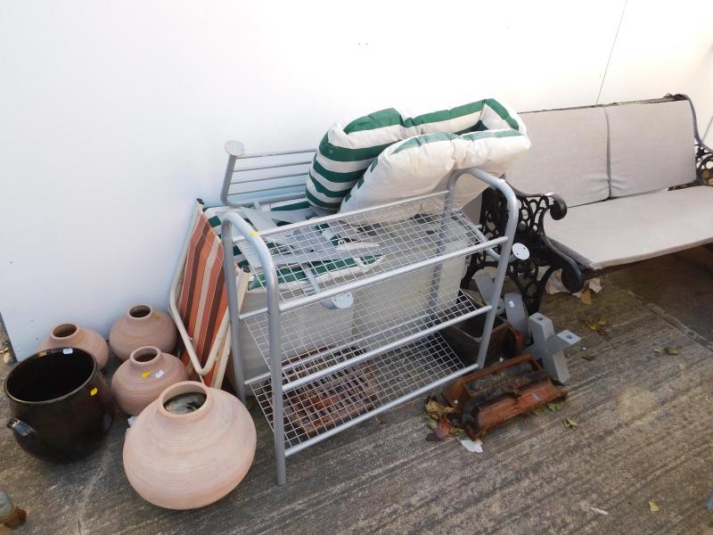 A garden bench with metal ends, metal shoe rack, various terracotta pots, etc. (a quantity)