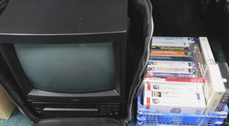 A GBI television with integrated video, in canvas travelling case, with various equestrian VHS Vide