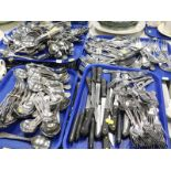 A large quantity of catering cutlery, to include soup spoons, knives, forks, steak knives, etc., (