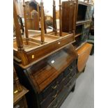 A collection of furniture, to include an oak gate leg table, glazed front bookcase, mahogany bureau,