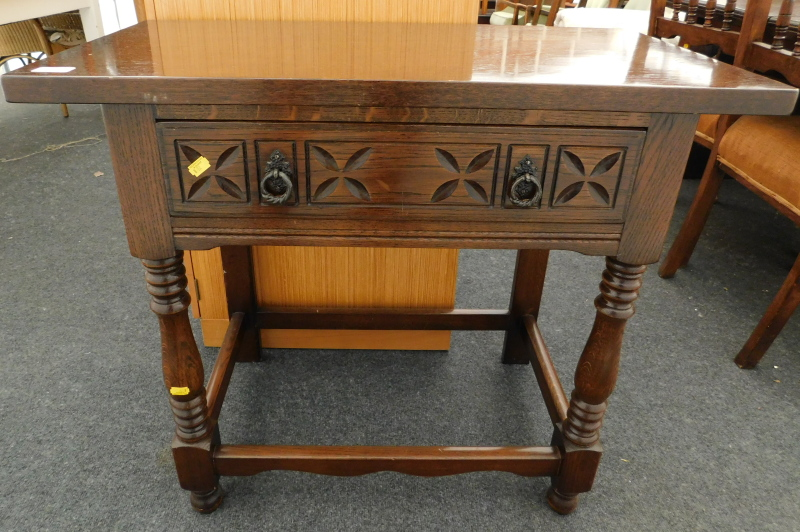 An oak Priory style side table, 70cm high, 82cm wide, 42cm deep.