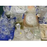 A quantity of glassware, to include vases, commemorative champagne flutes, part dressing table