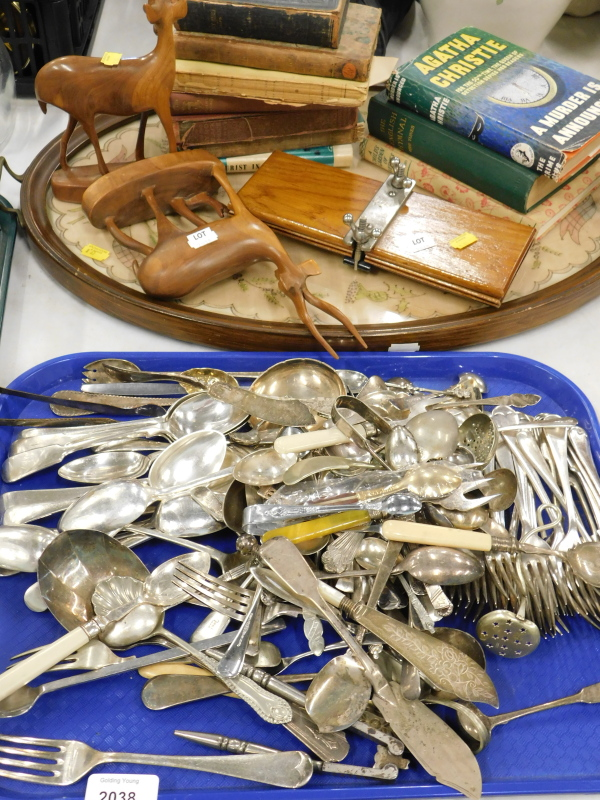 A quantity of loose flatware, to include fiddle pattern dessert spoons, fish knives, various books