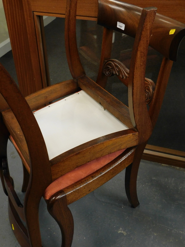 A pair of Victorian mahogany dining chairs, with drop in seats.