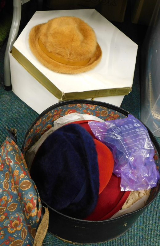 A quantity of ladies hats, to include a Christian Dior Diorling red felt hat, two Kangol hats,