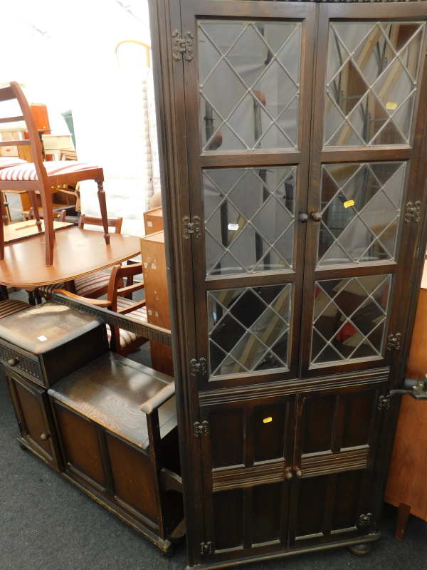 An oak Priory free standing corner cabinet, and a similar oak telephone table.