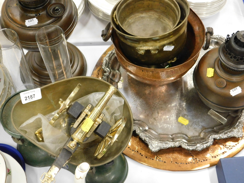 A hammered copper two handled vessel, oil lamp, metal scales, plated tray, etc. (a quantity)