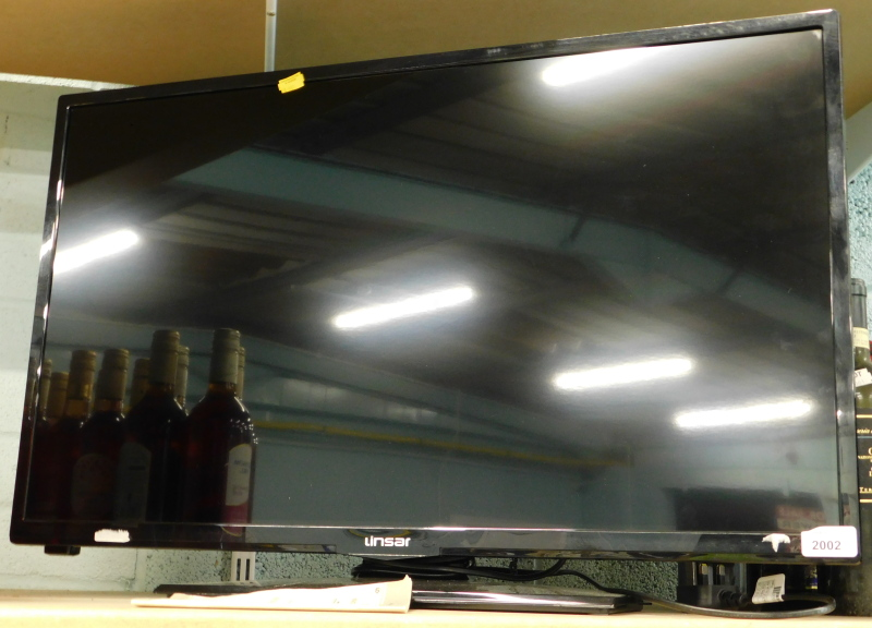 A Linsar 31 inch television, with lead, lacking remote.