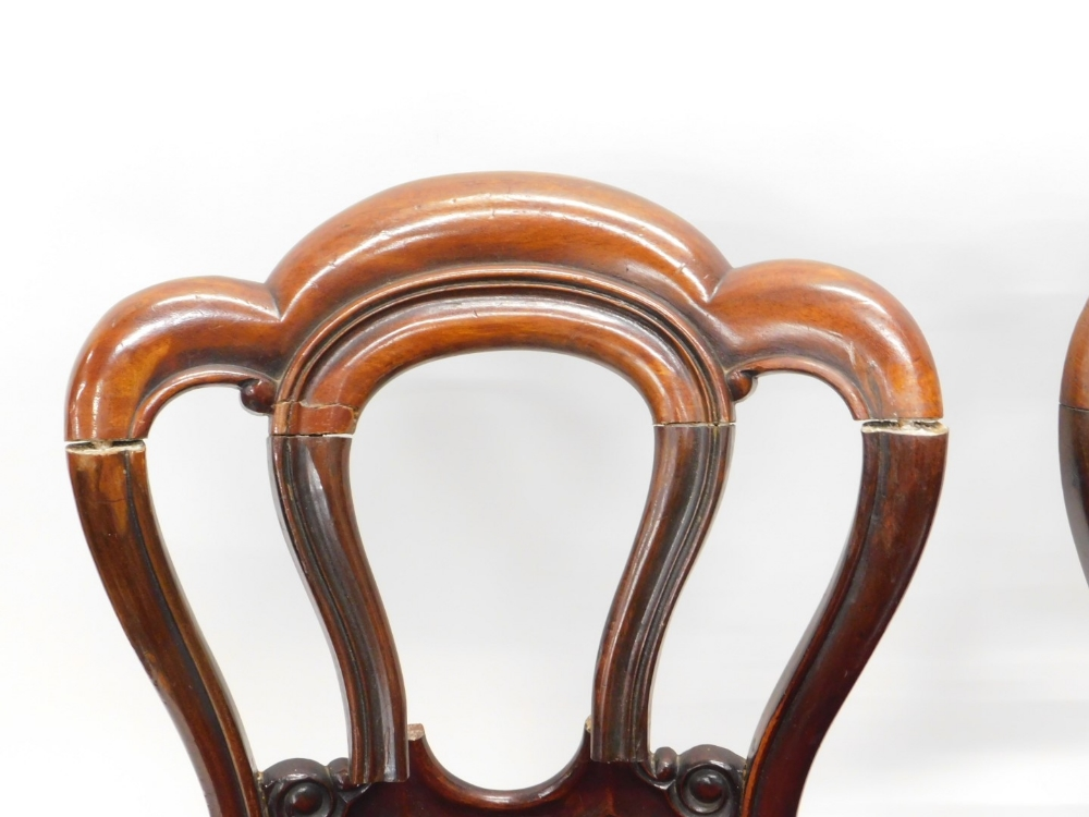 A set of four Victorian mahogany balloon dining chairs, each with a lobed back, a padded seat on - Image 2 of 2