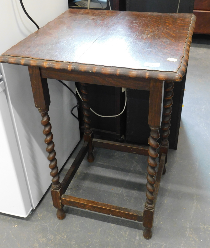An oak occasional table, with a square top, with pie crust border, on barley twist legs, the top