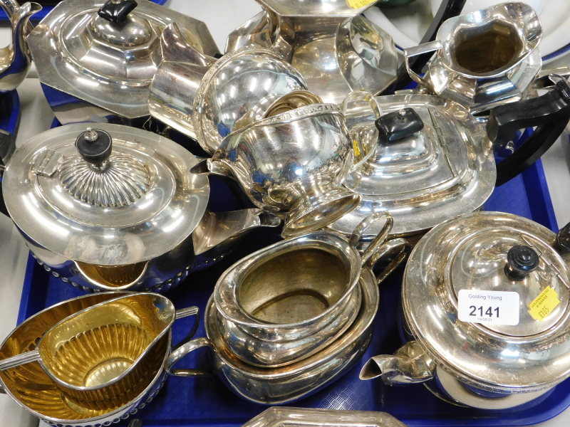A quantity of silver plated tea sets, to include teapots, milk jugs, sugar bowls, etc., (1 tray).