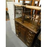 A pair of two drawer metal filing cabinets, a pair of bedroom chairs with rush seats, and an oak