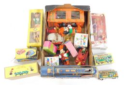 Games and toys, to include a Pelham Puppet Dutch Girl, tin plate playing ping pong, Golden Falcon