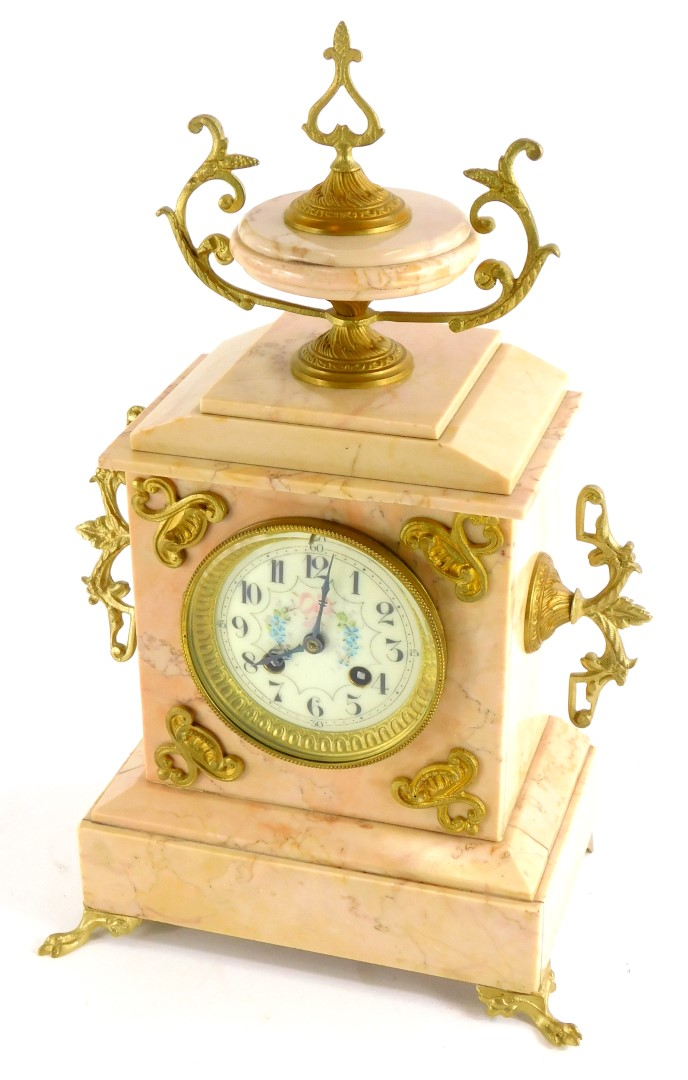 A French late 19thC pink marble mantel clock, with gilt metal mounts, the top with an urn finial abo