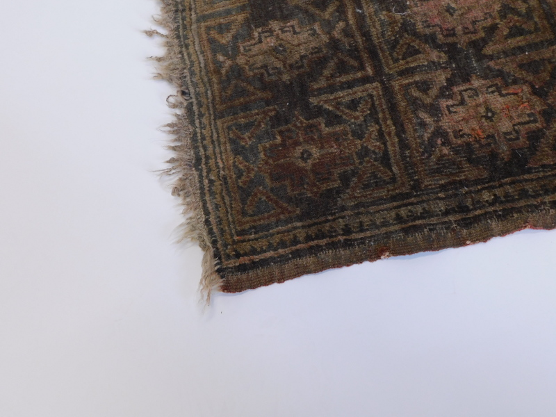 A small Turkish or Afghan mat, with a design of nine medallions, in red, on a brown ground, (AF), 55 - Image 2 of 3