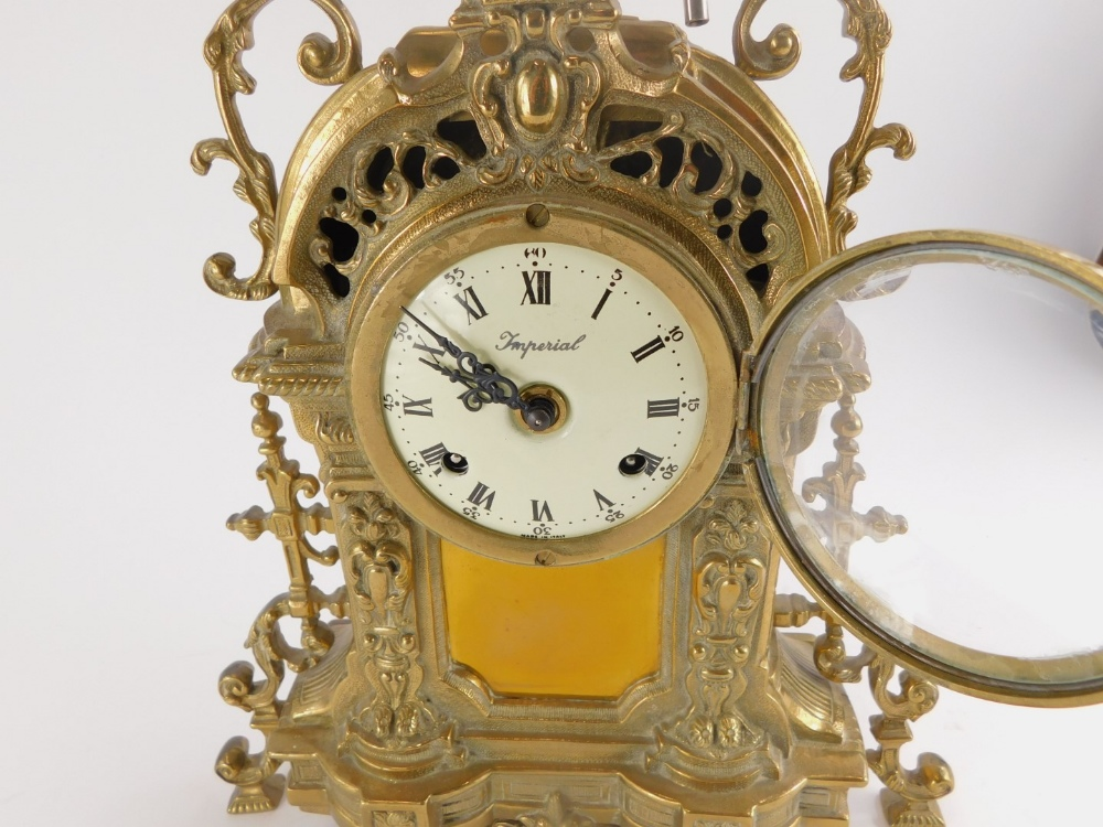 A Continental mantel clock, the rococo shaped cast brass case decorated with scrolls, the dial stamp - Image 2 of 3