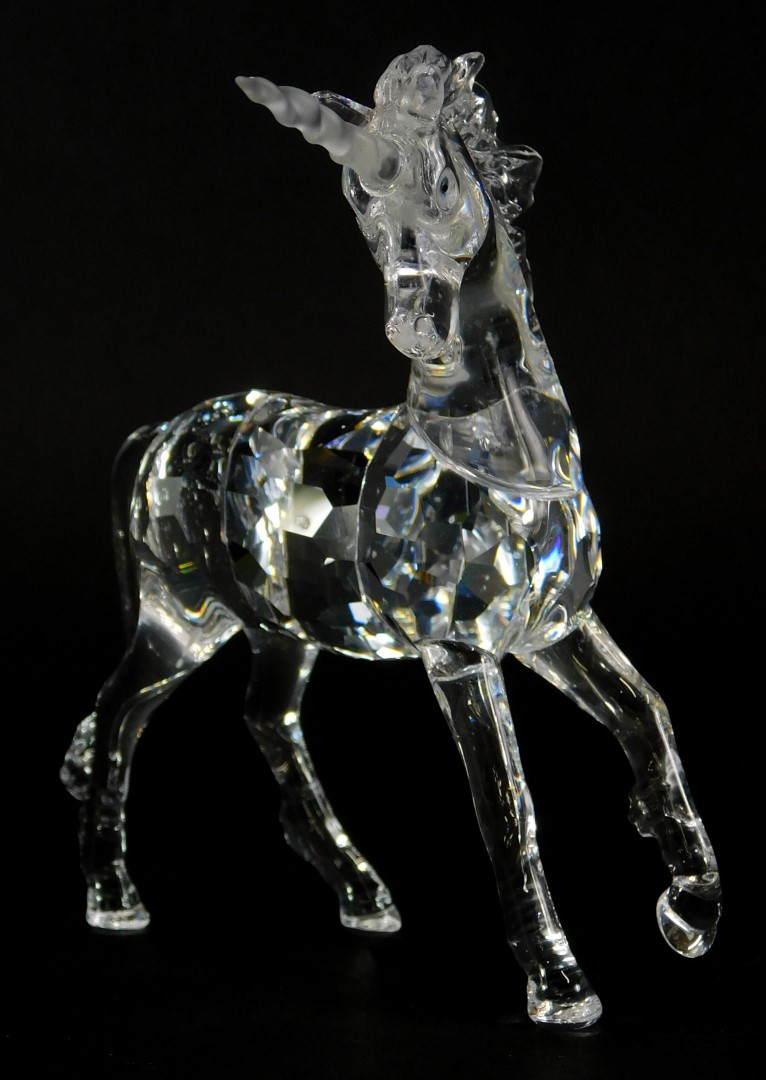 A Swarovski crystal model of a unicorn, 12cm high, in a fitted case.