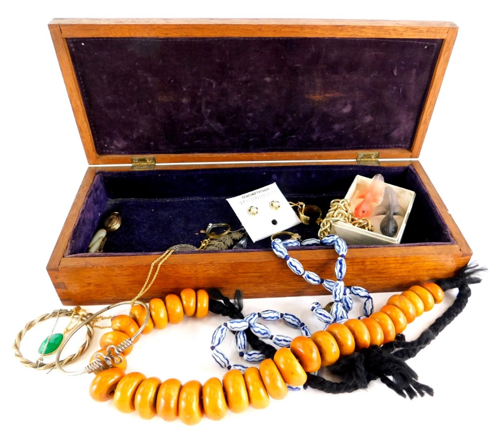 A group of costume jewellery, to include a wooden beaded necklace, two glass fish, modern gold finis