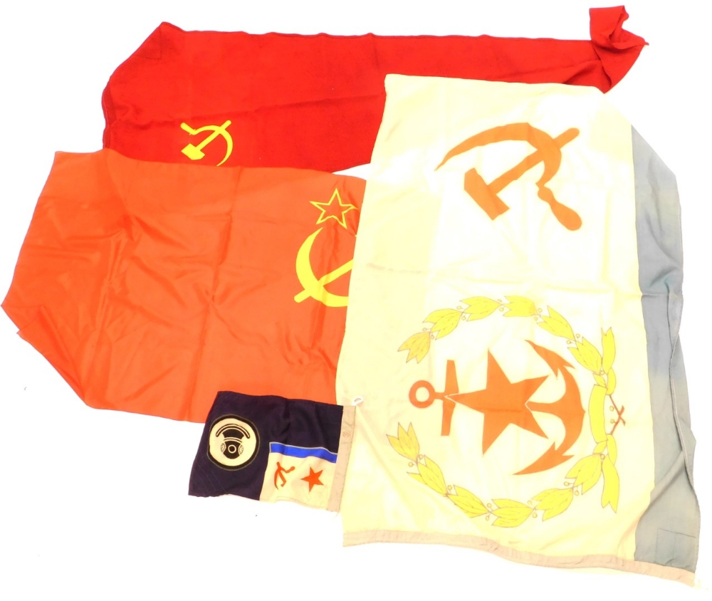 A collection of Russian flags, to include a ships pennant, an unusual flag with a gold wreath on a c