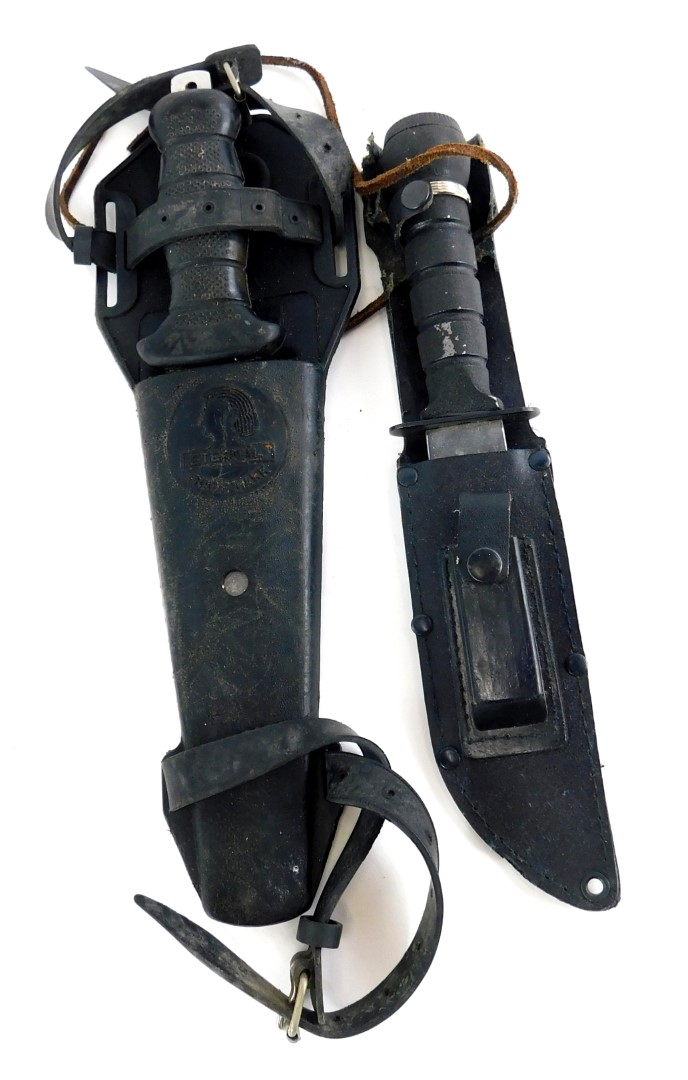 A diver's knife, the scabbard stamped Eternal, and another knife.