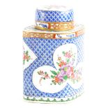 A continental porcelain lozenge shaped tea caddy and cover, decorated in oriental style wi