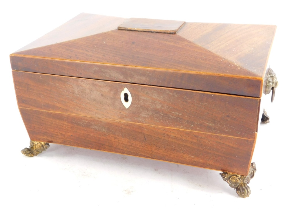 A mid 19thC mahogany and boxwood strung sarcophagus shaped workbox, the hinged lid enclosing a lined