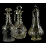 An engraved claret jug, with silver plated mount, 18cm high, a cut glass claret jug with stopper and