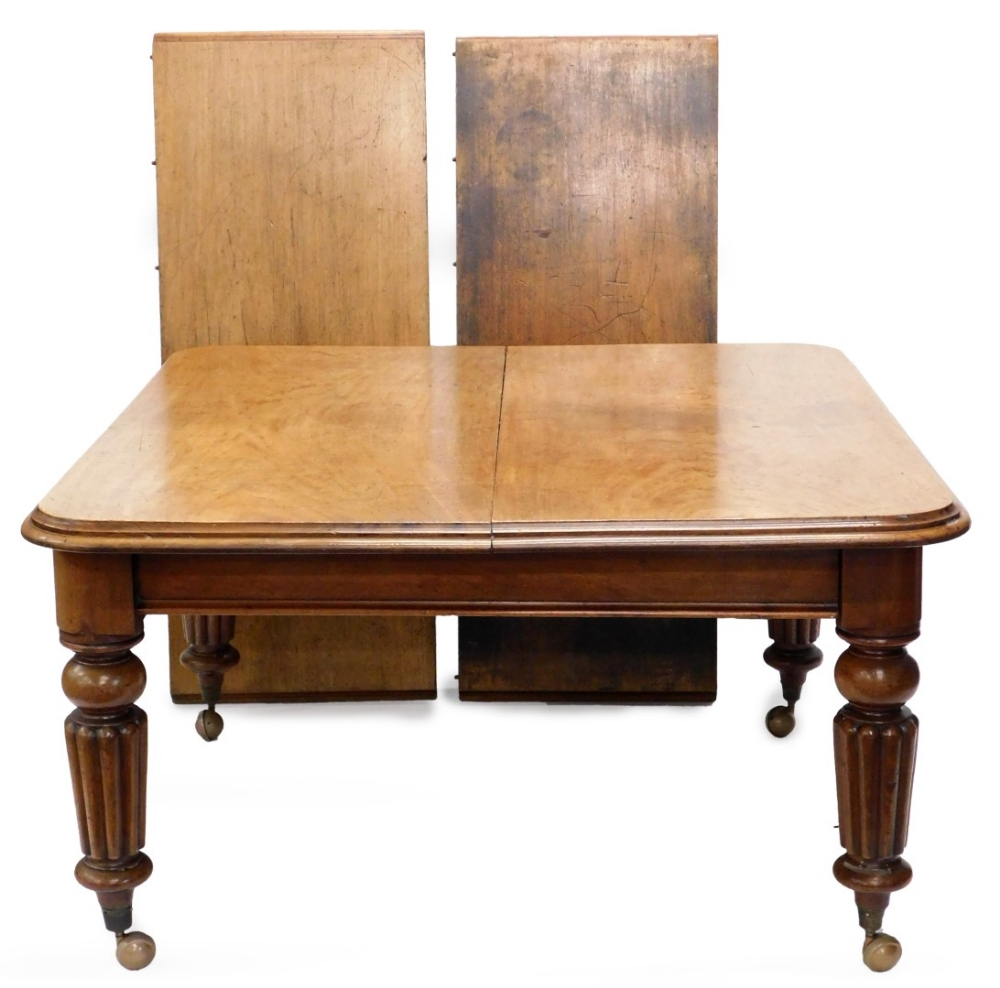 An early Victorian mahogany extending dining table, the rectangular top with a moulded edge, on turn