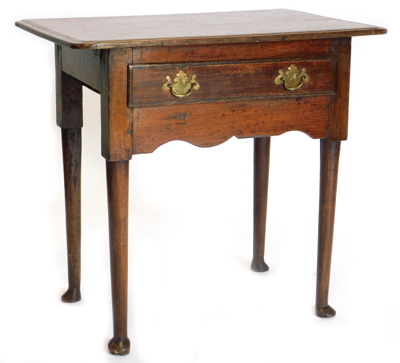 A late 18th/early 19thC oak lowboy, the top with a moulded edge above a frieze drawer, on turned tap