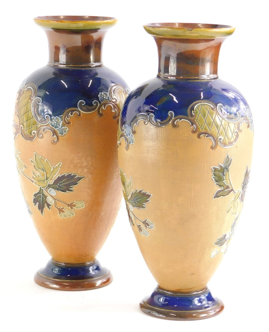 A pair of Royal Doulton Slaters patent vases, each with decoration of flowers and leaves within tube