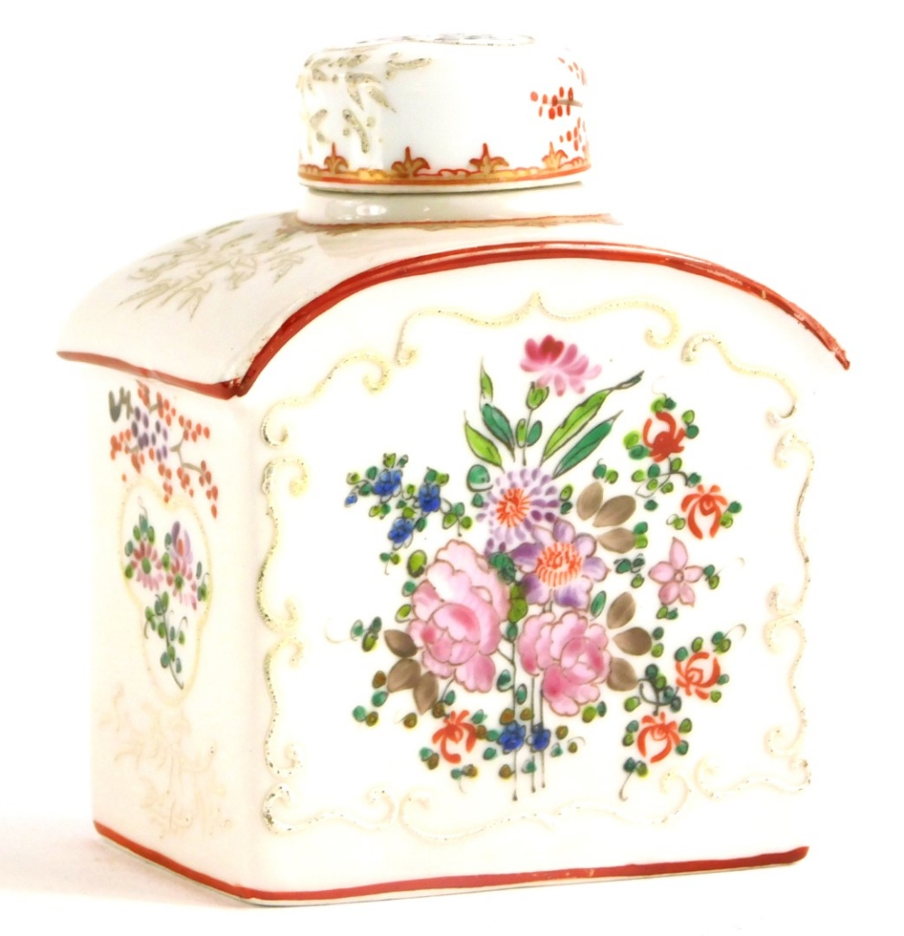A continental porcelain tea caddy and cover, decorated in oriental style with flowers, leaves, etc.,