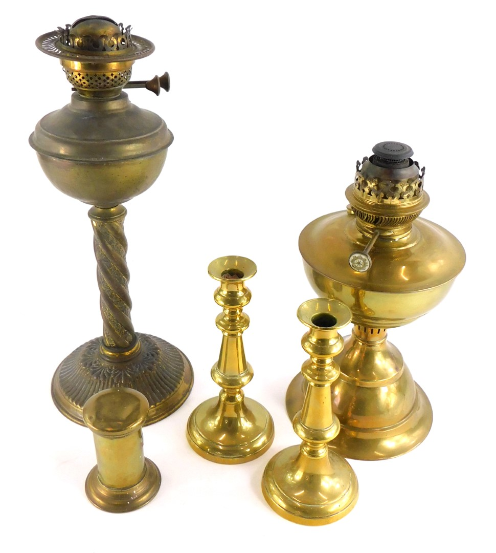 A late Victorian brass oil lamp, decorated with scrolls, etc., on a fluted base, another brass oil l