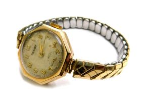 A Rotary 9ct gold wristwatch, with octagonal watch head, the silvered dial with gold hands, on a gol