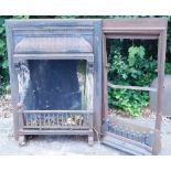 A late 19th/early 20thC cast iron fireplace, with grate, decorated with geometric devices, 71cm wide