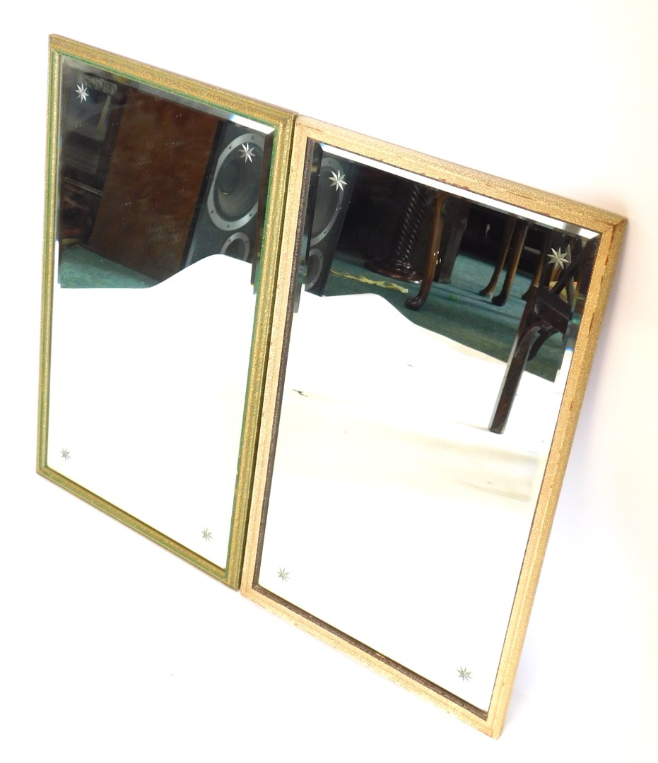 A pair of mottled gilt gesso wall mirrors, each with bevelled glass engraved with stars, 69cm high,