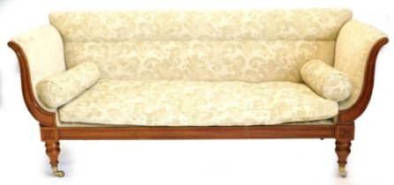 A William IV mahogany sofa, with leaf and scroll patterned upholstery, carved supports to the arms,