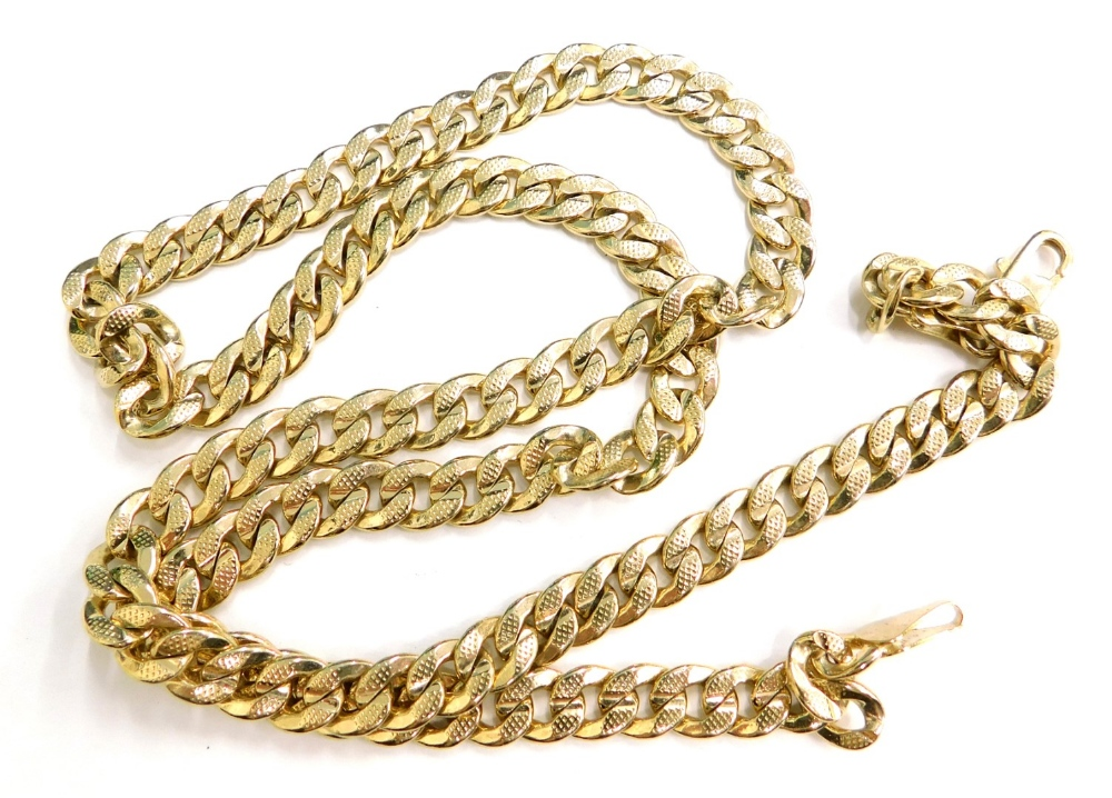 A curb link necklace, with heavy curb links and engraved decoration, yellow metal, marked 18k, 61cm