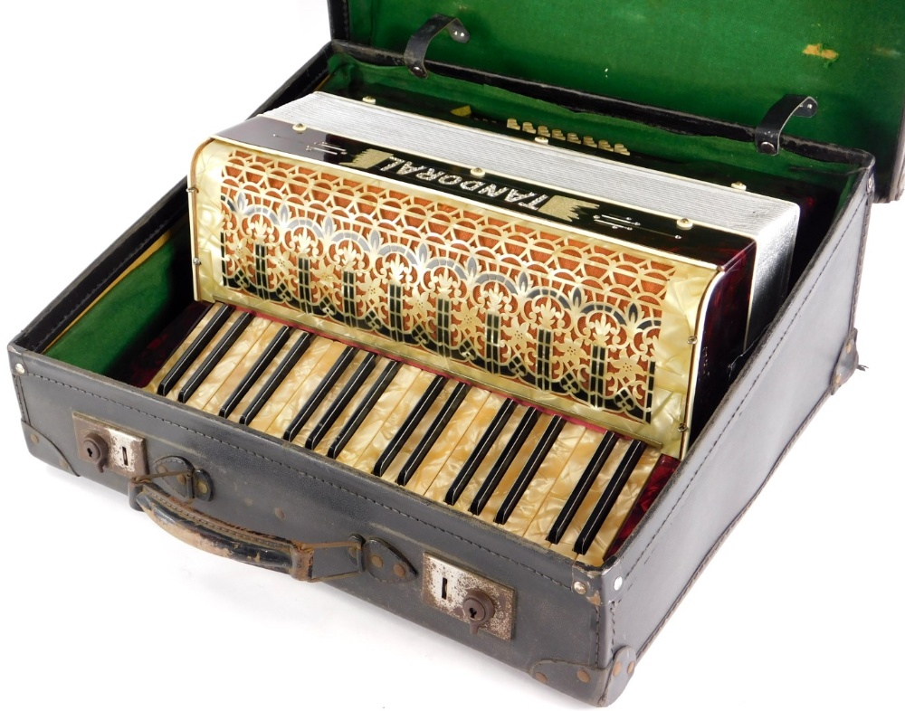 A Tandoral piano accordion, with marble effect decoration, in a fitted case.