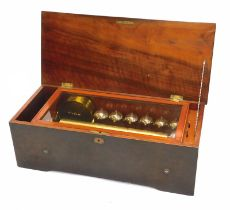 A late 19thC Swiss musical box, in a rosewood and marquetry case, the hinged lid enclosing a brass c