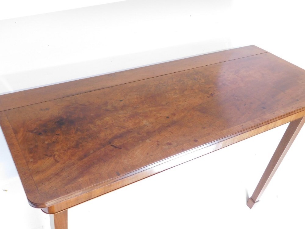 A mahogany folding table, the rectangular crossbanded top above a plain frieze on two hinged square - Image 2 of 2