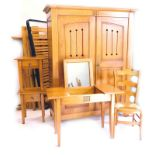 A French pine bedroom suite, comprising two door wardrobe with pierced panelled doors, enclosing she